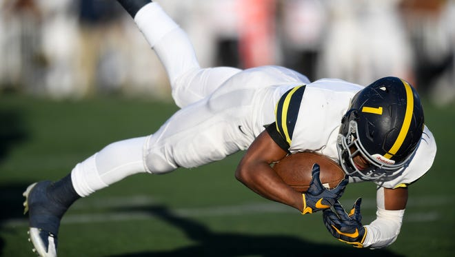 Lausanne's Eric Gray (1) dives in for a touchdown against Notre Dame during the first half of the Division II-AA state championship game at Tucker Stadium in Cookeville, Tenn., Saturday, Dec. 2, 2017.