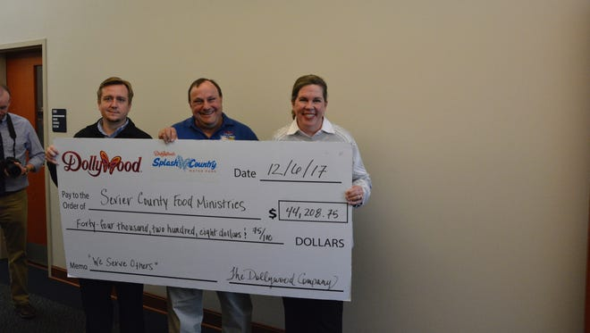 Dollywood presented a check for $44,208.75 to Sevier County Food Ministries on Wednesday, Dec. 6, 2017. From left are Jason Boothe, Dollywood vice president of operations; Jim Davis, director of Sevier County Food Ministries; and Janet Dawson, general manager of Dollywood's Splash Country.