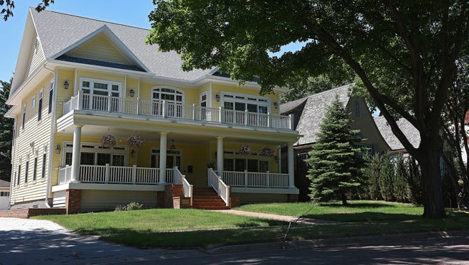 The homes of the Sapienza and McDowell families are shown June 27, 2016, in Sioux Falls, S.D. The McDowells won a lawsuit, upheld in the South Dakota Supreme Court, that would require the newer house to conform to neighborhood standards.
