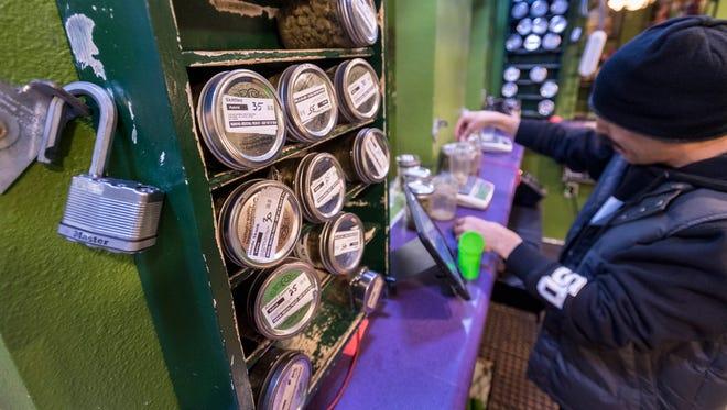 Raul Valdez weighs medical marijuana for a sale at Canna Can Help Inc. on Thursday, January 4, 2018.