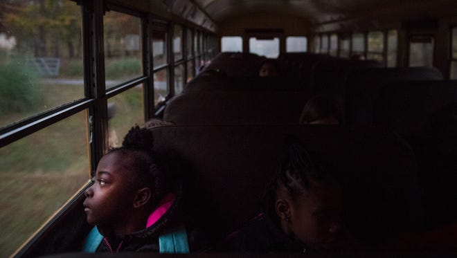 A student rides the bus to Fork Shoals Elementary on Tuesday, November 14, 2017.