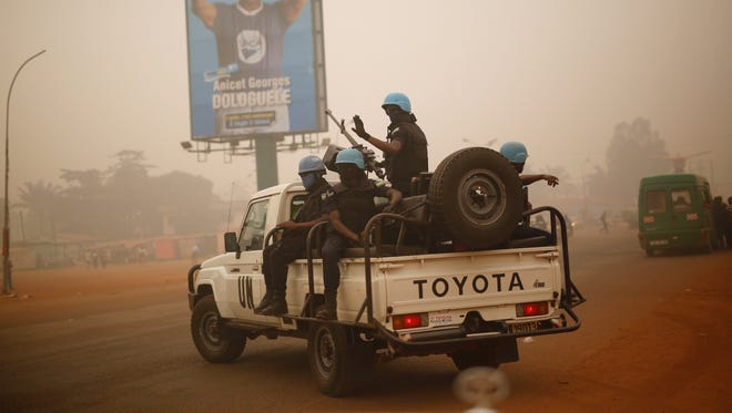 In this Feb. 12, 2016, file photo, U.N. forces from Rwanda patrol the streets of Bangui, Central African Republic.