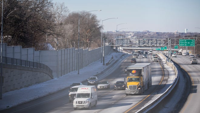 A stead stream of traffic passes below speed cameras on Interstate 235 just a head of the Polk Boulevard overpass on Wednesday, Jan. 17, 2018, in Des Moines.
