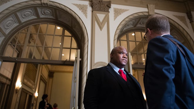Pastor Mark Burns is interviewed by the media at the Poinsett Hotel in Greenville on Friday, January 26, 2018.