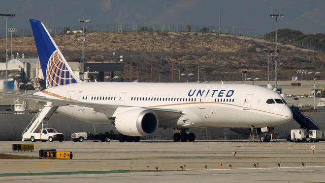 A Boeing 787 Dreamliner jet operated by United Airlines is shown parked at Los Angeles International Airport on Jan. 9, 2013. The FAA had grounded all U.S.-registered Boeing 787 jets for the repair of batteries believed to be linked to a fire risk.