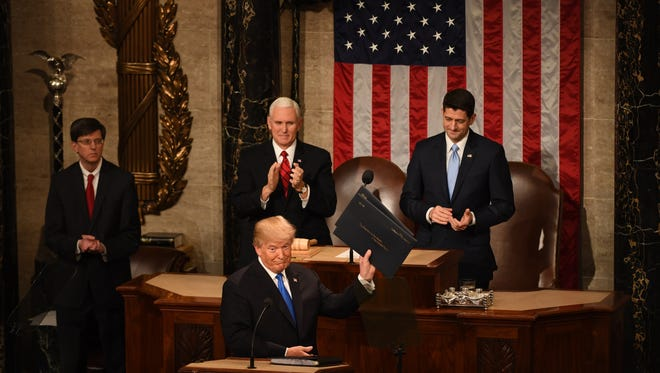 President Donald Trump acknowledges the audience before delivering the State of the Union address on Jan. 30, 2018 from the House chamber of the United States Capitol in Washington.