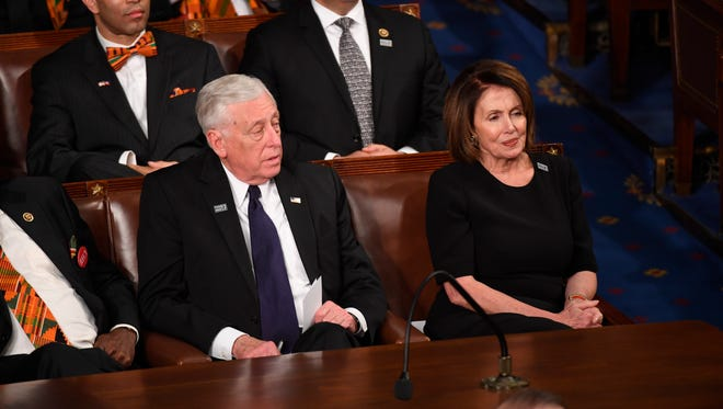 Rep. Steny Hoyer, D-Md., and Minority Leader Rep. Nancy Pelosi, D-Calif., listen as President Trump delivers the State of the Union Address.