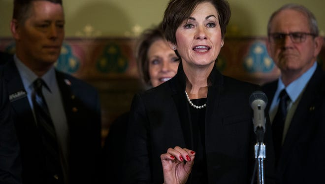 Kim Reynolds, Governor of Iowa, gives a speech before signing her first bill as governor, SF 512 which deals with water quality, on Wednesday, Jan. 31, 2018, at the Iowa State Capitol.