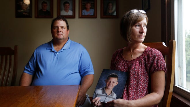 Scott and Sandy Van Veldhuizen with a photo of their son, Reuben at their home in Oskaloosa, Iowa. Reuben, 12, died in 2016 after complications from a tonsillectomy at an outpatient facility in Clive, Iowa.