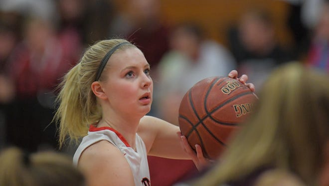 Alexis Rolph (11) of Lourdes concentrates on a free throw. The Lourdes Academy Knights hosted the Elkhart Lake-Glenbeulah Resorters in a WIAA Division 5, Sectional 4 game Friday evening, February 23, 2018 at the Castle.