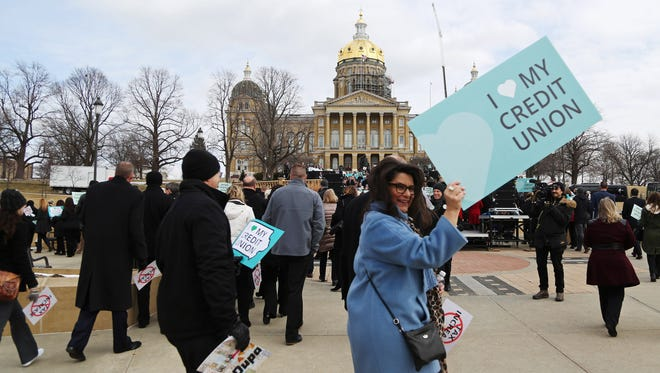 Hundreds of people gather on the steps of the Capitol to rally against increased taxes on credit unions in the state of Iowa on Wednesday, March 7, 2018, in Des Moines.