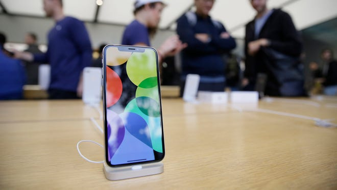 The new iPhone X is seen on display at the Apple Union Square store on Nov. 3, 2017, in San Francisco. The iPhone X's lush screen, facial-recognition skills and $1,000 price tag are breaking new ground in Apple's marquee product line. Now, the much-anticipated device is testing the patience of consumers and investors as demand outstrips suppliers' capacity.