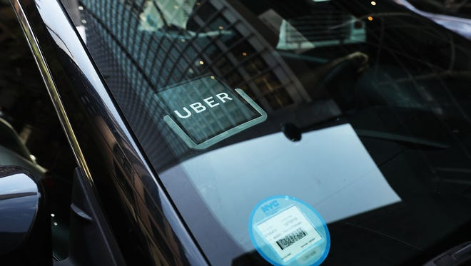 FILE - Uber car waits for a client