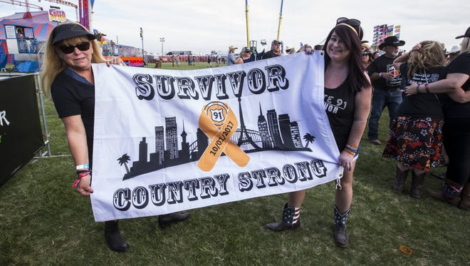 Kim Vickers, left, and Michelle Vickers, survivors of the Route 91 Harvest Festival shooting, pose for a portrait during Day 2 of Country Thunder Arizona on Friday, April 6, 2018.