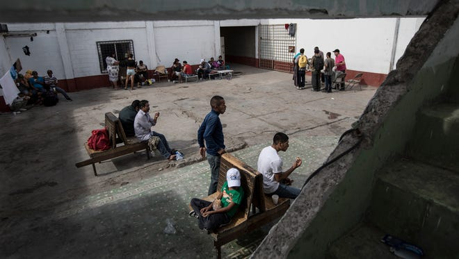 Migrants rest in the patio at the Alfa & Omega migrant Shelter in Mexicali, Mexico, Thursday, April 26, 2018. In the last 24 hours close to 200 migrants from Central America, mostly from Honduras, arrived in Tijuana seeking to enter the United States.