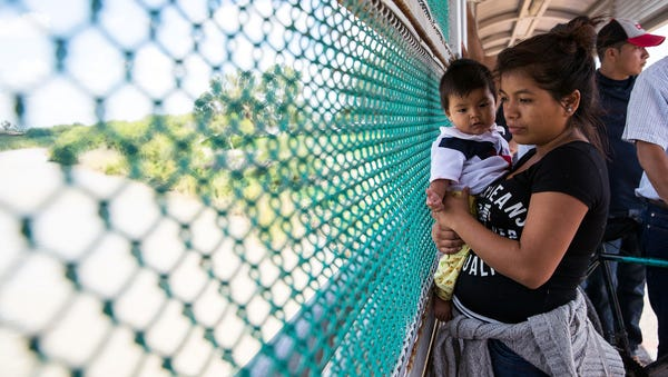 A Guatemalan woman and her child seeking asylum...