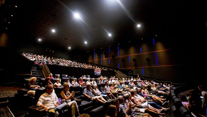 """Hundreds of audience members listen to opening remarks on July 16, 2018, during a showing of the Arizona Republic's Pulitzer Prize-winning project """"The Wall"""" at Harkins Theater in Scottsdale, Arizona."""