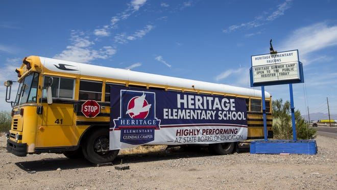 A school bus with a sign for Heritage Elementary School is pictured on Tuesday, July 17, 2018, in Glendale, Ariz.