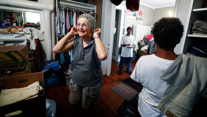 Margery Wolcott, co-founder of Constance Abbey, tries on a hat in the mission's clothes donation room inside their home on Hamlin Pl. Wolcott and her husband Roger moved to Memphis from the West Coast and followed a faith-based calling to start a mission of hospitality for the homeless. They open their open home four-days a week offering counseling and services to the needy.
