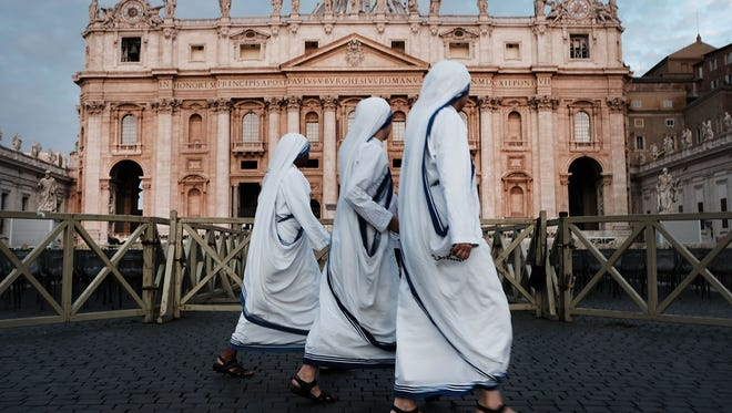 A group of nuns walk through St. Peter's Square at dawn on Sept. 3, 2018, in Vatican City, Vatican.