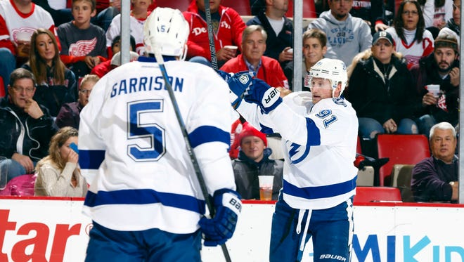 Tampa Bay Lightning center Steven Stamkos (91) celebrates a goal with defenseman Jason Garrison (5) skates over to congratulate in the first period against the Detroit Red Wings at Joe Louis Arena.
