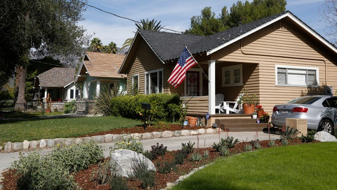 """This Feb 12, 2014 file photo shows a home in the """"Bungalow Heaven"""" district in Pasadena, Calif."""