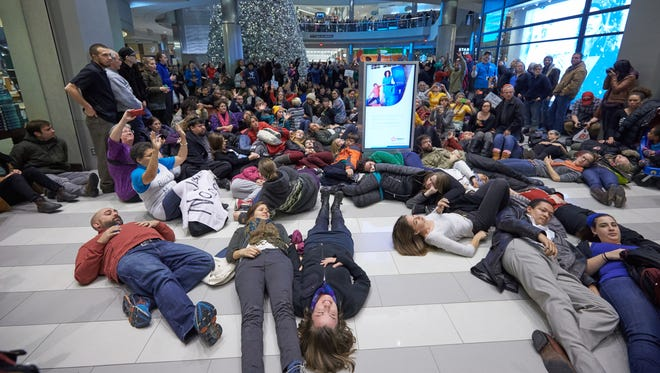 """Thousands of protesters from the group """"Black Lives Matter"""" disrupt holiday shoppers Saturday at the Mall of America in Bloomington."""