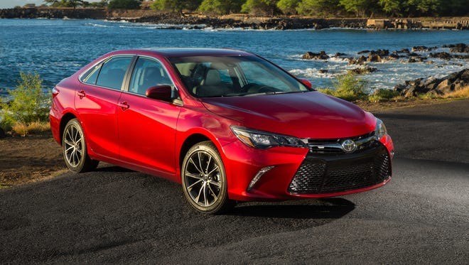 Updated 20o15 Toyota Camry has startling new grille, improved interior and controls and XSE V-6 sport model that's actually pleasant to drive thanks to tires, chassis, transmission tuning.