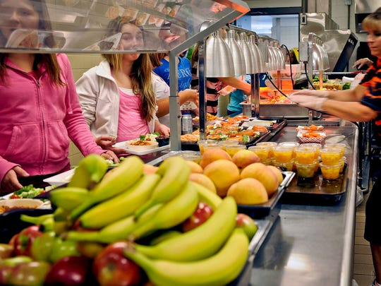 Students are given healthy choices on a lunch line at Draper Middle School in Rotterdam, N.Y. in 2012.