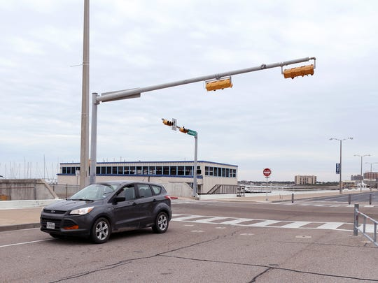 A vehicle drives down a now opened section of Shoreline Boulevard near the Art Center of Corpus Christi on Thursday, December 14, 2016.