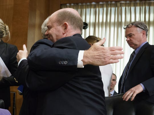 Sen. Chris Coons, D-Del., is embraced by Senate Foreign