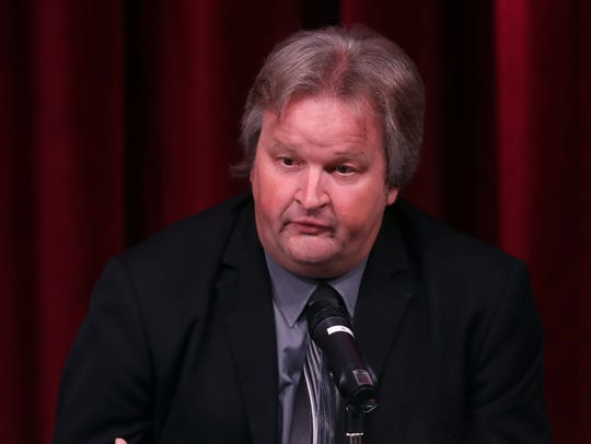 Jeff Napier speaks during a mayoral forum hosted by