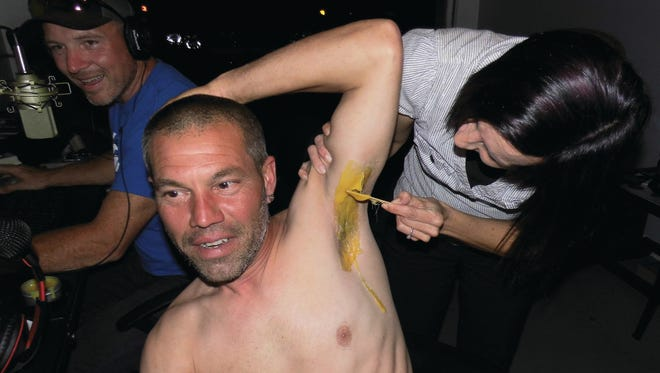 Tonia Priore-Dentzau coats Jaime Eisenhour's armpit with hot wax. Priore-Dentzau also pulled the wax off live on Facebook in a stunt that rated $1,180 for anti-bullying/suicide awareness campaigns.