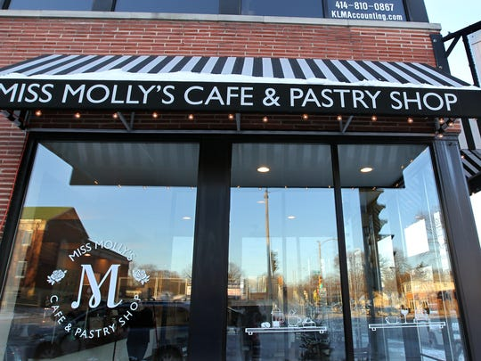 Striped awnings make Miss Molly's Cafe & Pastry Shop