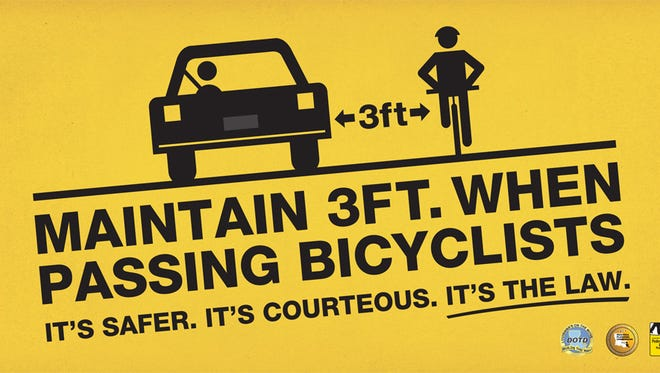 A bike safety sign from Louisiana.