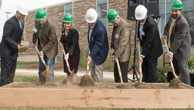 Colorado State University President Tony Frank, right, breaks ground with representatives from JBS USA and the College of Agricultural Sciences on March 27. The university will build the JBS Global Food Innovation Center in Honor of Gary and Kay Smith.