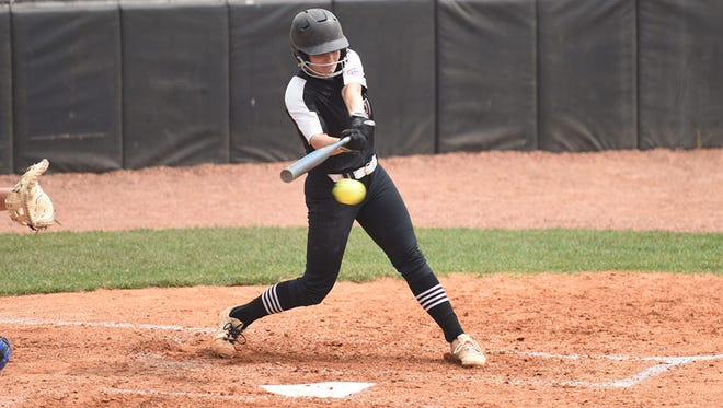 Freed-Hardeman senior infielder Caitlyn Carter swings at a pitch during a tournament game earlier this season.
