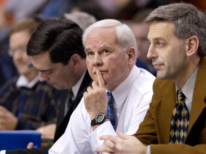 Indiana State University head basketball coach Royce Waltman, center, watches  his Sycamores fall to the Creighton Bluejays 76-46 at the Hulman Center in Terre Haute in 2003