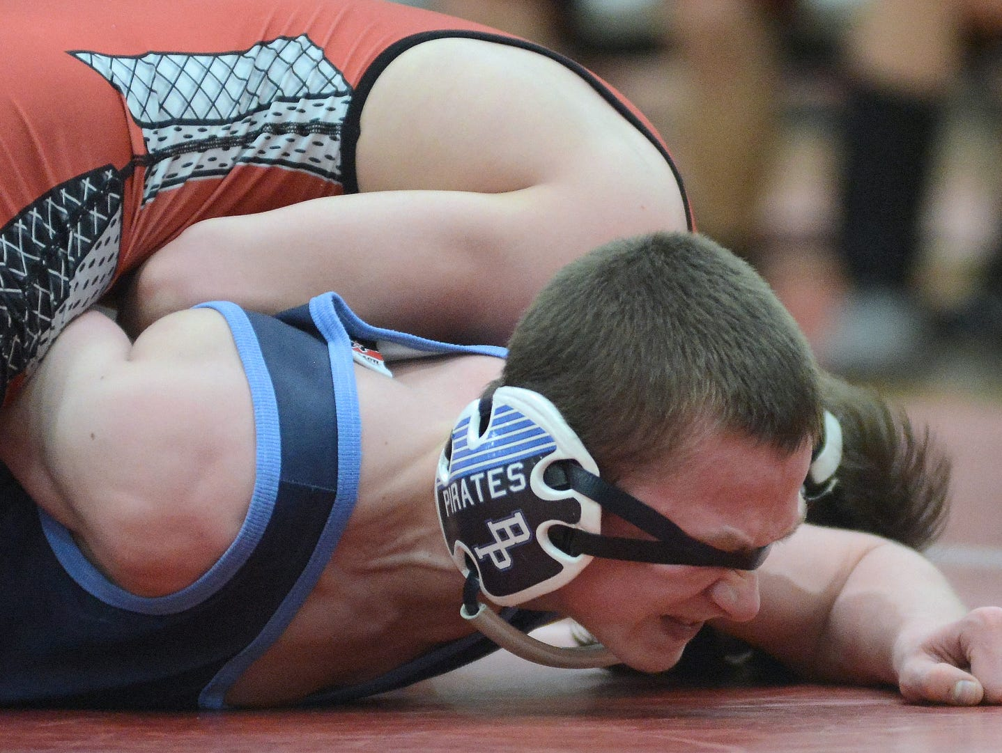 Wisconsin Rapids Lincoln's Matrix Jisko controls Bay Port's Jarod Maes, who is blinded by his out-of-position headgear in their 113-pound match during a WIAA Team Sectional at Pulaski High School in Pulaski, Wis. on Tuesday, Feb. 17, 2015.