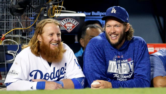 Los Angeles Dodgers' Justin Turner and Clayton Kershaw all smiles in the 9th inning during their 8-5 win over the Arizona Diamondbacks in Game 2 of the NLDS on Saturday, Oct. 7, 2017 at Dodger Stadium in Los Angeles, California.