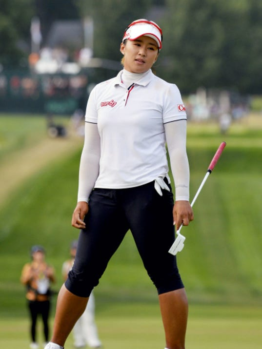 Amy Yang of South Korea watches as her putt misses the 18th hole for a bogey during Sunday's championship round of the U.S. Women's Open at Lancaster Country Club.