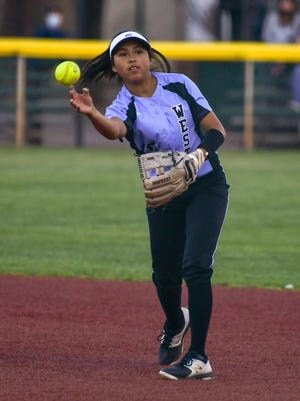 Pueblo West High School sophomore Ilyssa Calderon throws a runner out from second base during the Hornet Invite in September.