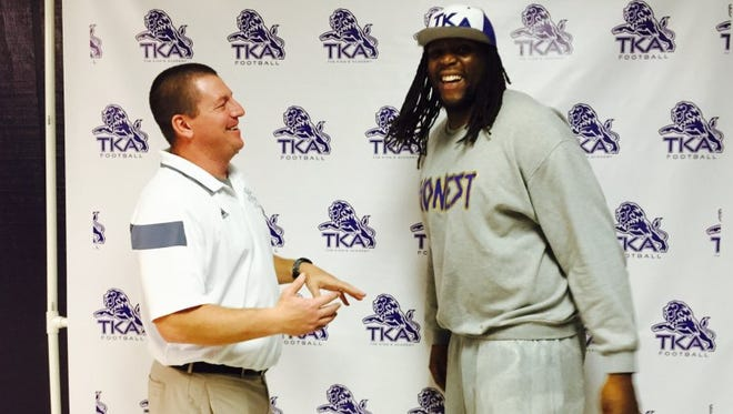"""The King's Academy head football coach Matt Lowe, left, stands with the school's new offensive line coach Antonio """"Tiny"""" Richardson in February."""