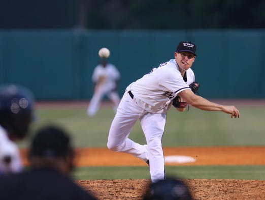 Louisville Bats' Dylan Axelrod delivers the pitch home in their game against the Columbus Clippers.  July 21, 2014