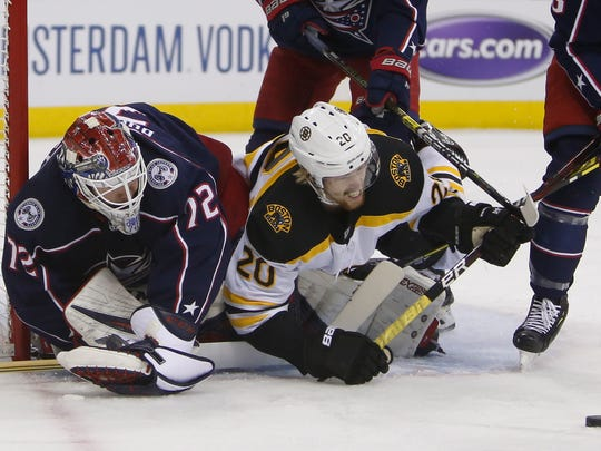 Columbus Blue Jackets' Sergei Bobrovsky, left, of Russia, makes a save as Boston Bruins' Joakim Nordstrom, of Sweden, collides with him during the first period of Game 3 of an NHL hockey second-round playoff series Tuesday, April 30, 2019, in Columbus, Ohio. (AP Photo/Jay LaPrete)
