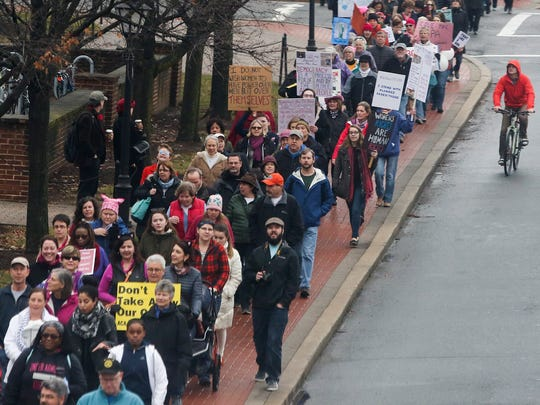 Marchers make their way along South College Avenue during the Newark Women's March held in conjunction with the Washington, D.C., event Saturday.