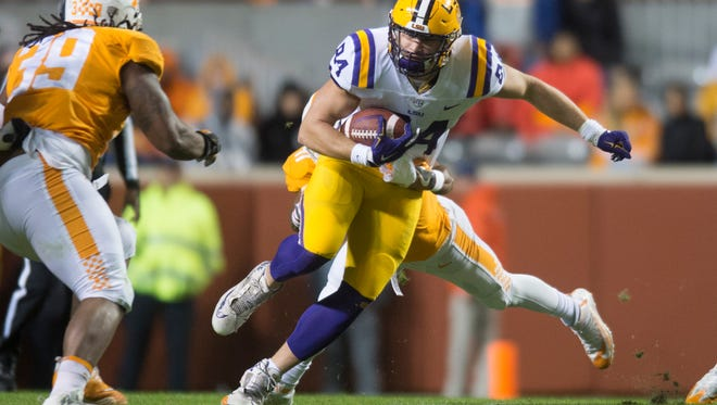 LSU tight end Foster Moreau (84) runs the ball during a game between Tennessee and LSU at Neyland Stadium in Knoxville, Tennessee, on Saturday, Nov. 18, 2017.