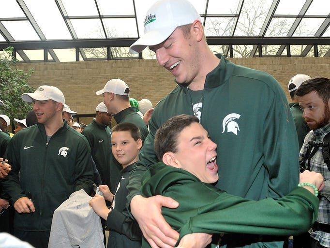 Young fan James Hinton gives a delighted Michigan State
