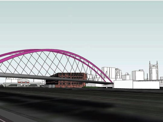The Metro Public Works Department has scaled back the conceptual design of a planned $18 million Gulch-SoBro pedestrian bridge.