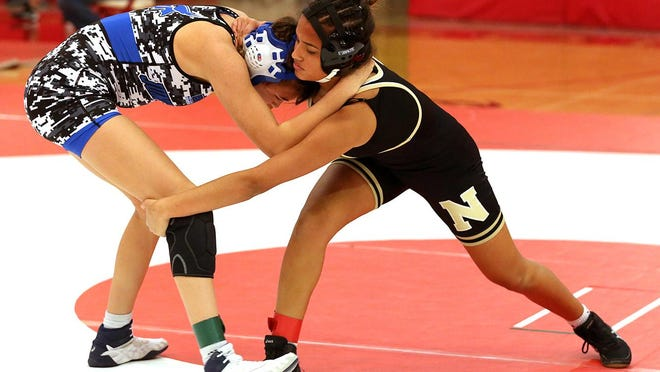 Junction City's Charly Goodwin defeated Newton's Emily Torres by fall in the 155-pound weight class Saturday at the McPherson Wrestling Invitational.